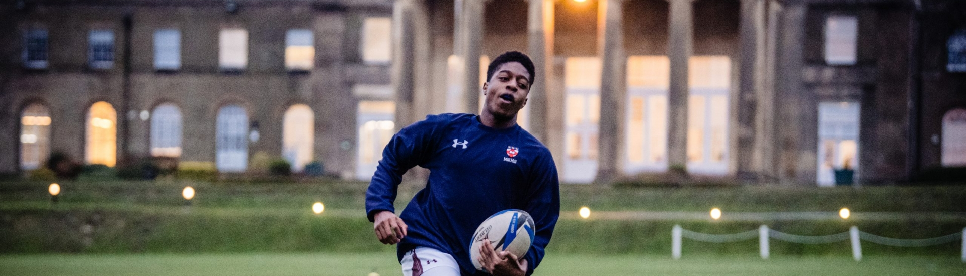 Student Playing Rugby